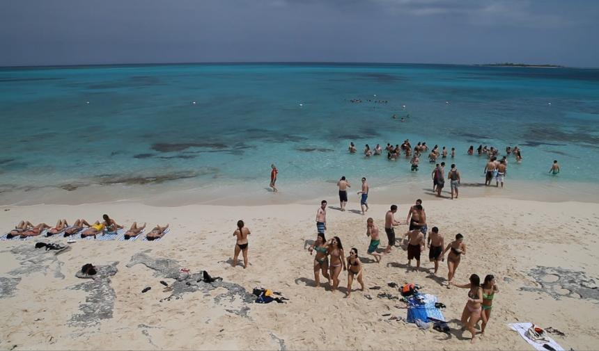 Students on the beach on a graduation trip to Cancun, Mexico