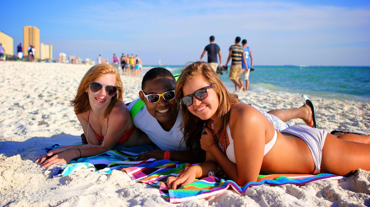 3 friends on the beach in Panama City Beach during spring break