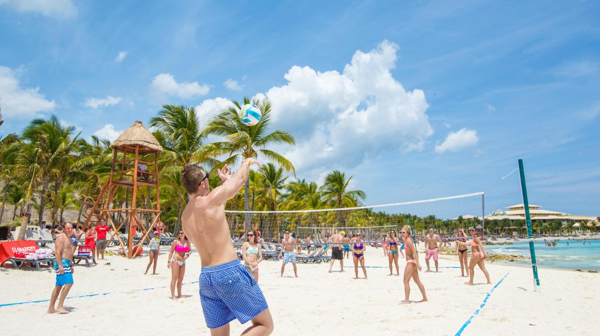 High schoolers playing volleyball on the beach in Riviera Maya.
