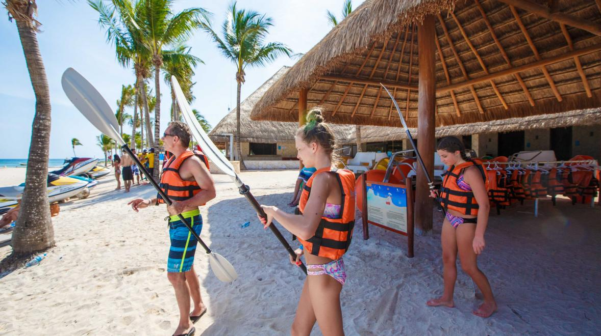 High schoolers getting ready to go kayaking, one of the many additional activities, during their stay at Riviera Maya.